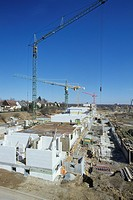 Germany, Building site, Shell with cranes