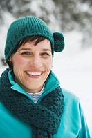 Italy, South Tyrol, Woman in winter clothes, smiling, portrait, close_up