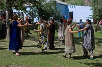 Dancing guests at wedding at Pamiris, Bartang Valley, Tajikistan, Central Asia, Asia