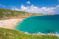Holidaymakers and tourists sunbathing on Porthcurno beach, Cornwall, England, United Kingdom, Europe