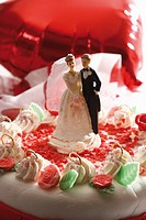 Wedding cake topper with bride and groom