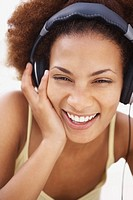 Close up of a black woman enjoying music