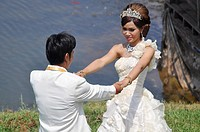 Angkor (Cambodia): newly-weds after the wedding ceremony, at Angkor Wat