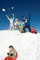 Italy, South Tyrol, Seiseralm, Family in snow, having fun, boy on sledge