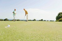 Spain, Mallorca, Senior couple playing golf