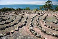 A labyrinth of stones on a flat rock