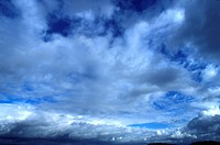 Dark Clouds In Blue Sky