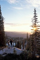 Couple Standing On A Mountain And Watching The Sun Rise