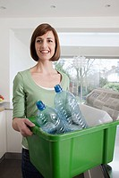 Woman doing recycling (thumbnail)
