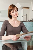 Woman looking at envelopes