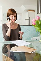 Woman on telephone with credit card