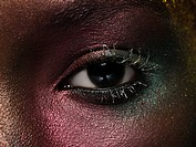 Female eye covered in metallic make up