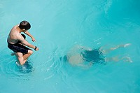 Boys playing in swimming pool, Auckland