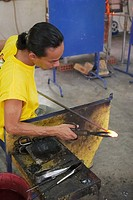 Shaping hot glass  Handicraft Cultural Complex, Langkawi island, Malaysia