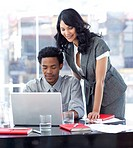 Businesswoman and businessman working in office together