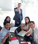 Happy business people in a meeting with thumbs up