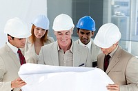 A group of architect discussing a project in a building