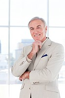 Portrait of a smiling senior businessman in a business building