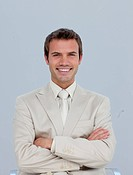 Portrait of smiling young businessman with folded arms