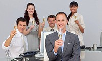 Successful business co_workers toasting with Champagne in the office