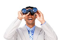 Happy businessman looking through binoculars against a white background