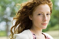 Young red_haired woman outdoors, portrait