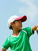 Close_up of a boy playing baseball