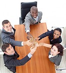 HIgh view of business team toasting with champagne in a meeting
