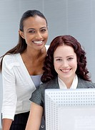 Beautiful businesswomen working together in office and smiling at the camera