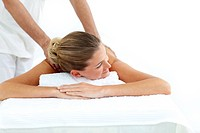 Attractive woman receiving a massage in a spa center