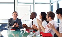 International business people applauding in a meeting