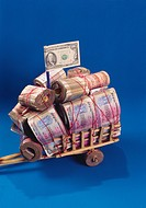Indian currency , cash bundles tied in cart on blue background