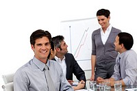 Smiling male executive at a presentation with his team in the office