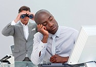 Unhappy businessman getting bored and his manager looking through binoculars in the office