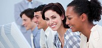Smiling business people showing ethnic diversity at work