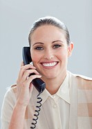 Portrait of a smiling businesswoman talking on phone in the office
