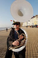 Musicians in the De Propere Fanfare belgian marching band performing on the promenade, Aberystwyth Wales UK