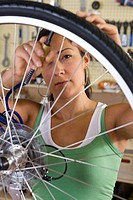 Business owner inflating bicycle tires workshop of bike shop