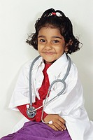 Girl dressed as doctor stethoscope around neck MR152