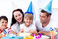 Young family celebrating a birthday at home