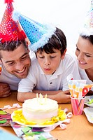 Little boy celebrating his birthday with his parents at home