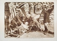 Wounded soldier on stretcher at first aid postin trench in Flanders during the First World War, Belgium