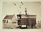 Soldier standing on dovecote letting out carrier pigeons at De Panne in Flanders during the First World War, Belgium