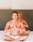 Young couple on budha position on bed together