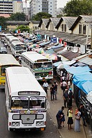 Asia, South Asia, Sri Lanka, Colombo, Pettah, Buses Lined Up Alongside Market Stalls
