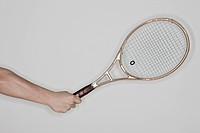holding tennis racket