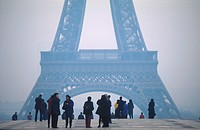 People in the fog in front of the Eiffel tower, Paris, France, Europe
