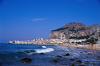 Beach and the town of Cefalu under blue sky, Cefalu, Sicily, Italy, Europe