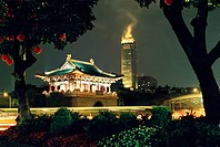Old city gate and Mitsukoshi Tower at night, Taipei, Taiwan, Asia