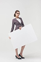 portrait of businesswoman holding white board